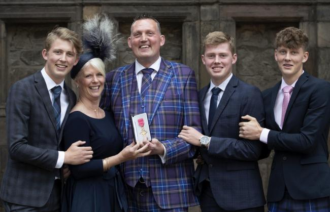 Former Scotland Rugby international and Motor Neurone campaigner Doddie Weir, with wife Kathy and their three sons (from left) Hamish, Ben and Angus, after receiving his OBE from Queen Elizabeth II during an Investiture ceremony at the Palace of Holyroodh