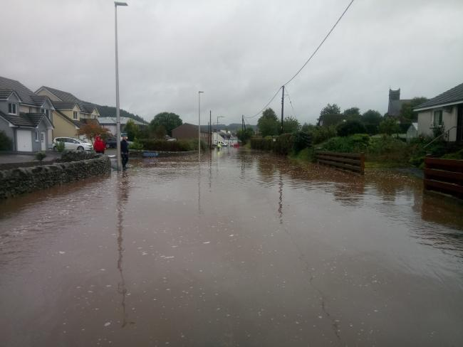 Around 100 metres of road was under water. Photo: Andrew Lees