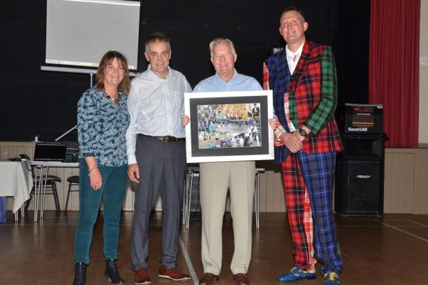 John Steede collects his lifetime achivement award from Leagh Douglas, Bruce Scott and Doddie Weir