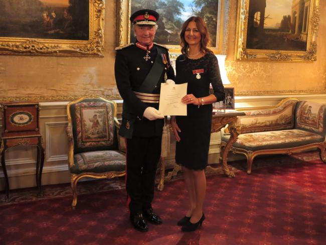 Amanda received the BEM fromThe Duke of Buccleuch,