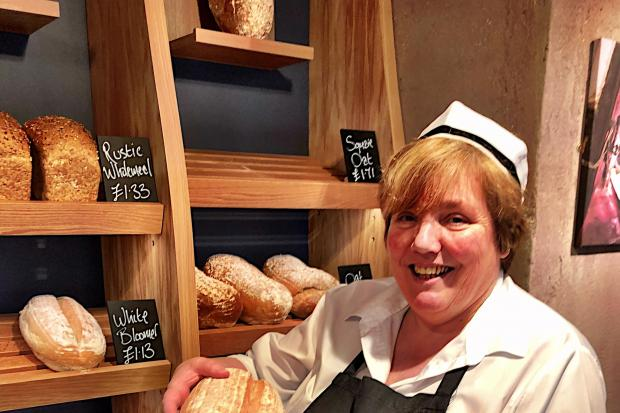 Lindsey Thomson serving the artisan bread from the Bank Street shop