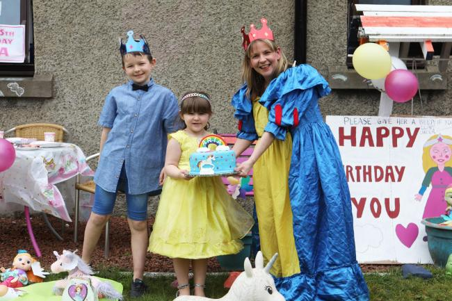 Aria Lynas, of Innerleithen, celebrates her fifth birthday with mum Donna Leslie and brother Kian. Photo: Helen Barrington