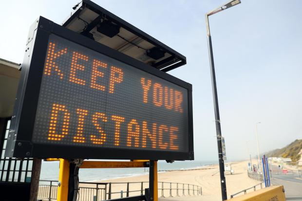 A 'Keep your distance' sign