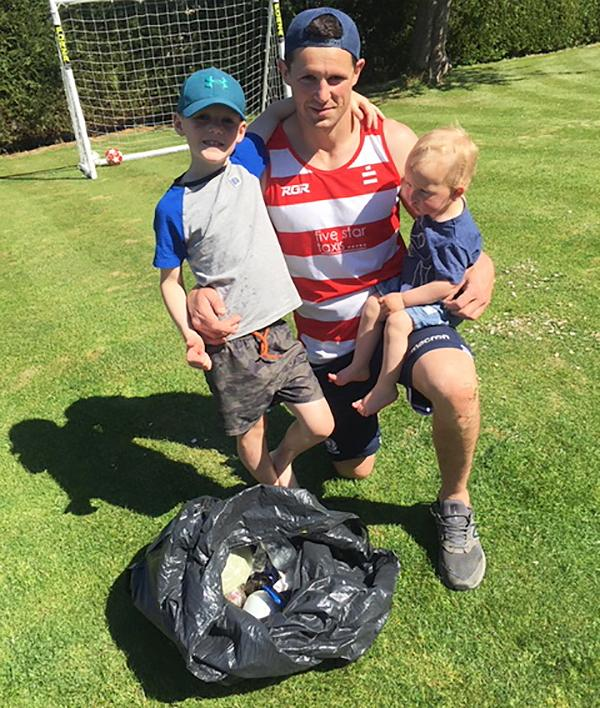 Selkirk player Ross Nixon pictured with sons Harry (left) and Jacob after a spot of litter collection