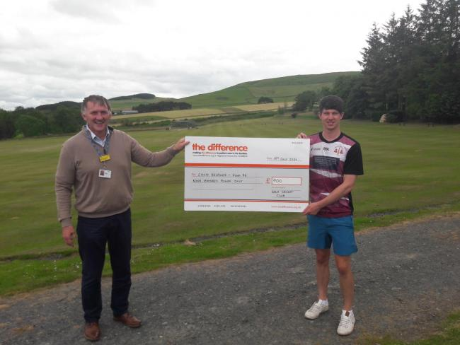 Brian Renwick, fundraising officer at The Difference, receives a £900 cheque from Ross Patterson of Gala Cricket Club