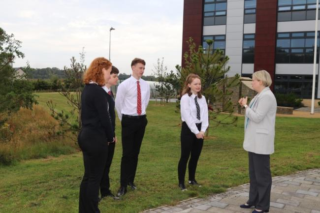 Councillor Shona Haslam (leader of Scottish Borders Council) welcomes pupils back to Kelso High. Photo: SBC
