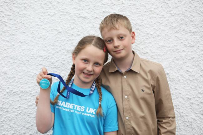 Peebles fundraiser Beth Johnson, aged eight, with her 12-year-old brother Oliver. Photo: Helen Barrington