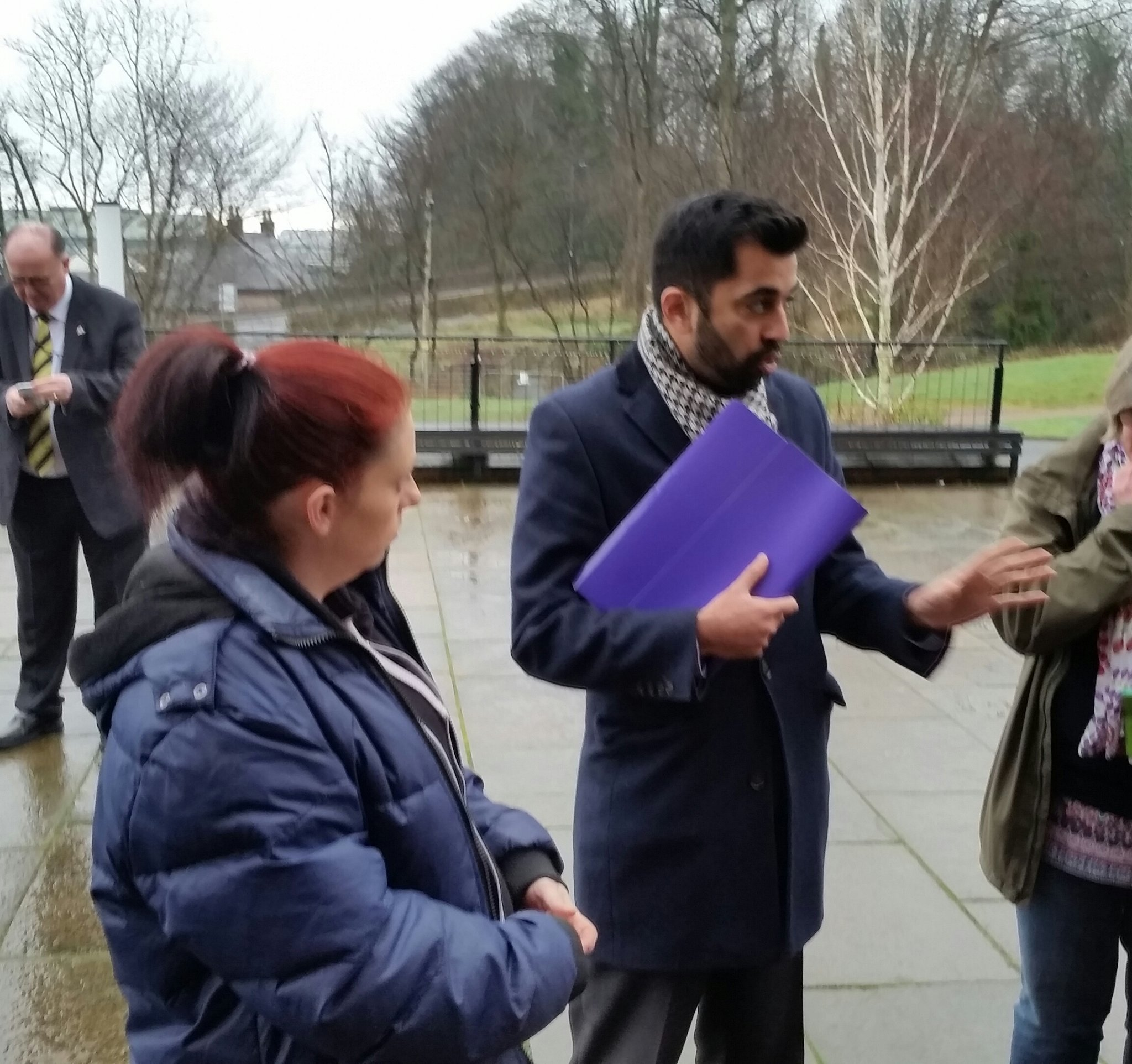 Terri Jan Lambie hands over the petition signatures to Humza Yousaf..