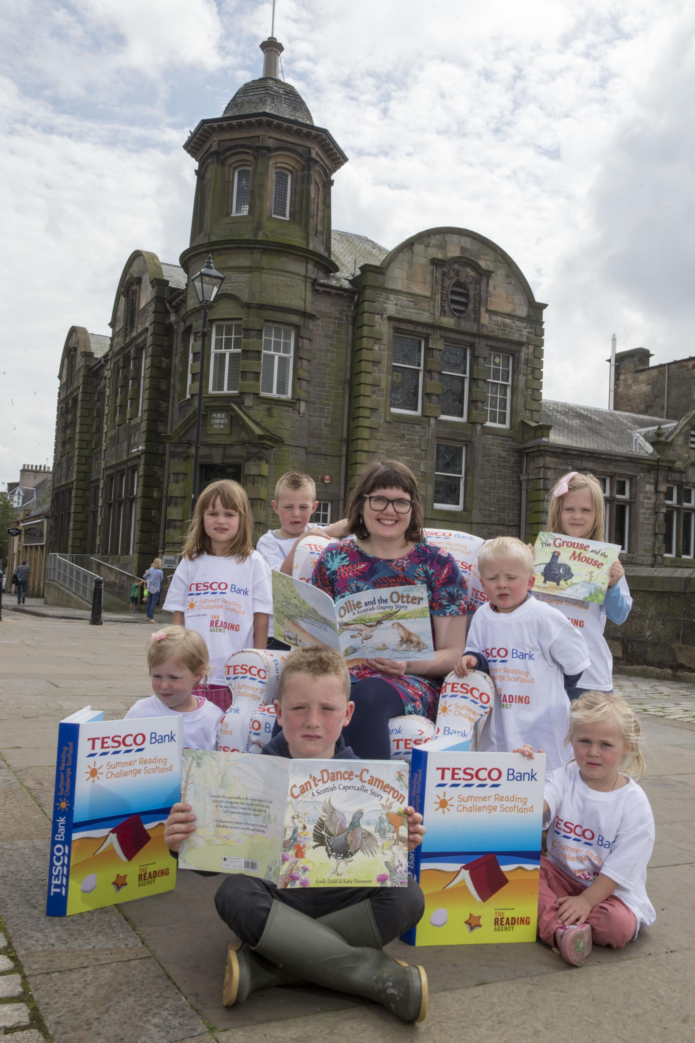 Author Emily Dodds with local children... Rowan, Daisey, Oliver, Abical, Ella, Robbie and Harry