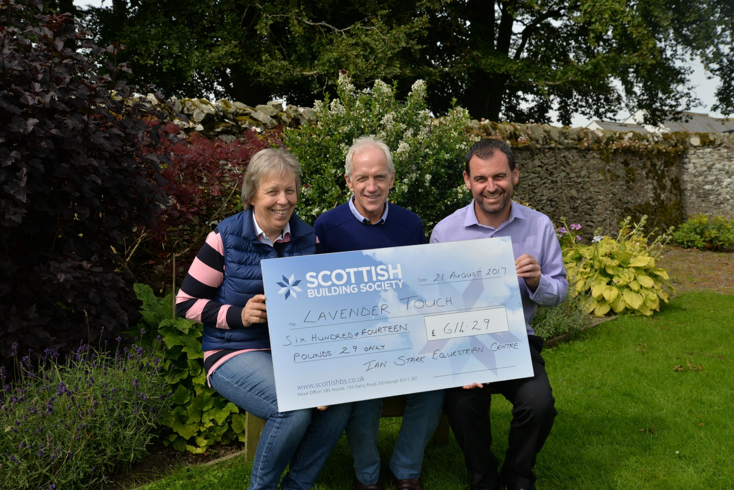 Alex Moffat (Lavender Touch) being presented with a cheque by Jenni and Ian Stark (Ian Stark Equestrian Centre)
