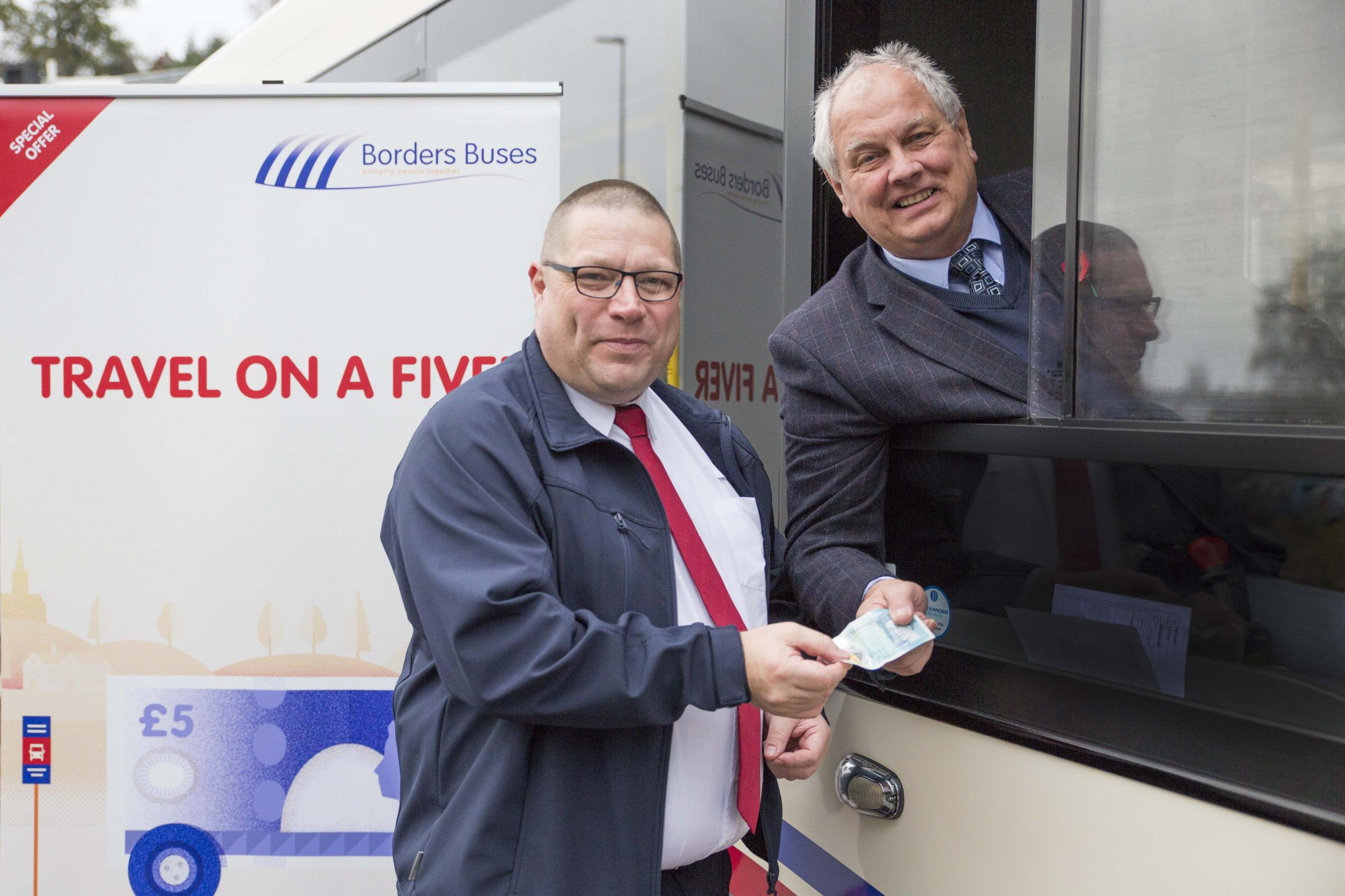 Lee Young, Operations Manager with Borders Buses in Galashiels and councillor Gordon Edgar.