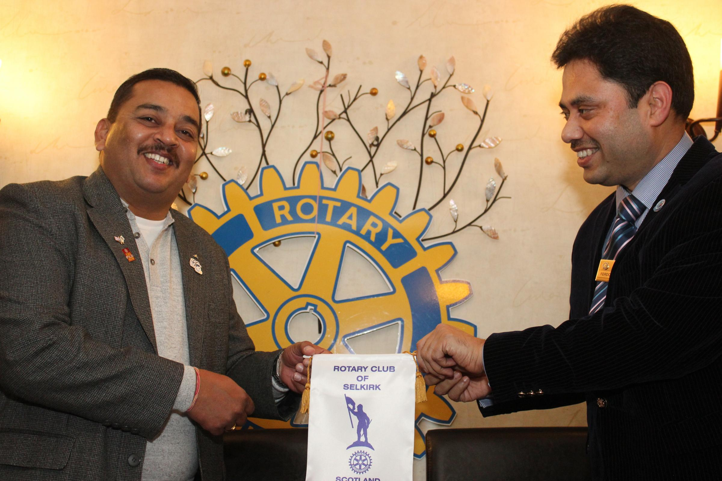 Hrushikesh K Keskar (left) is presented with the Selkirk Rotary Pennant by Ferdous Ahmed, President of Selkirk Rotary Club