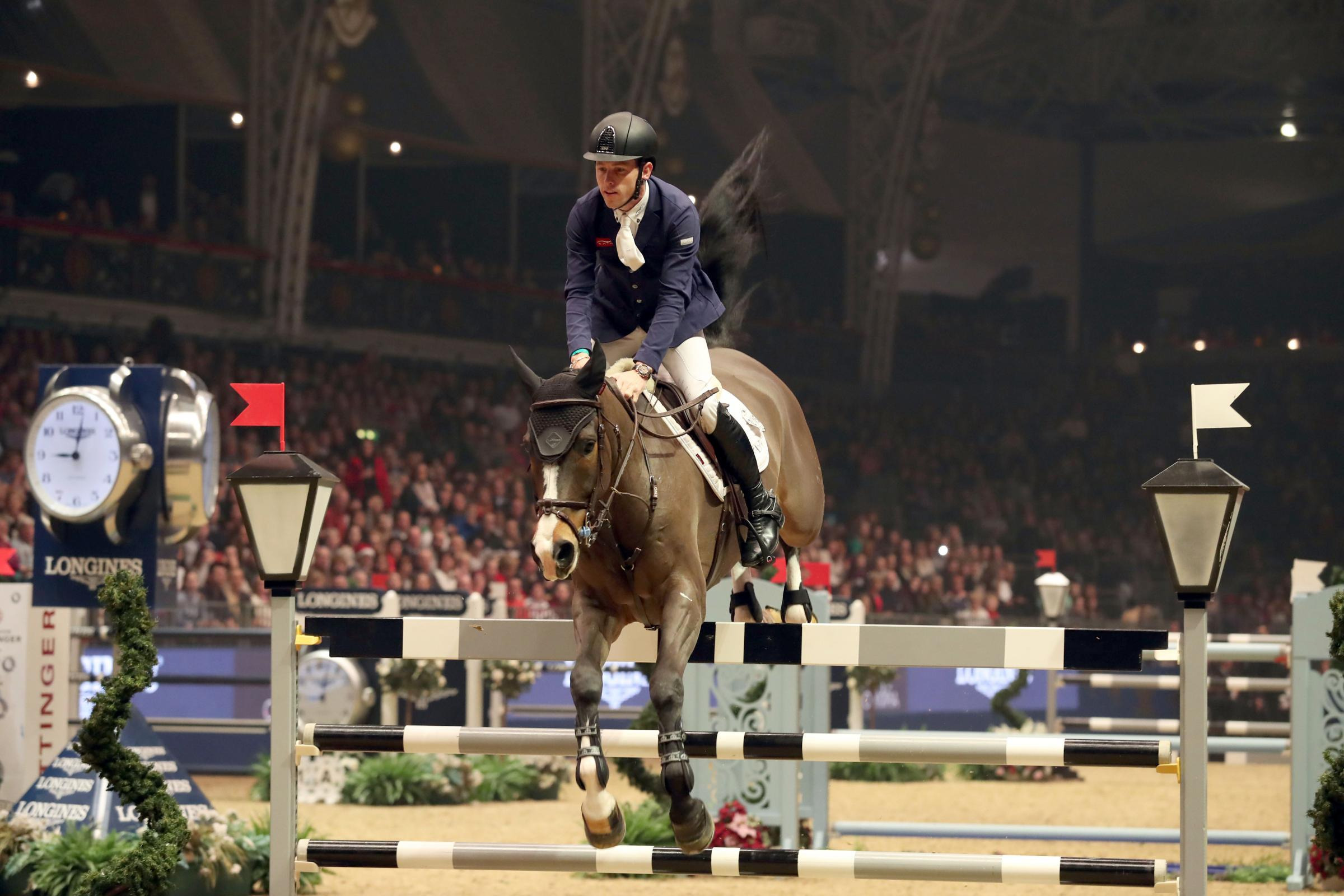 Scott Brash riding Hello Shelby competes in the Christmas Cracker at the London International Horse Show at Olympia. Photo: Steve Parsons/PA Wire.