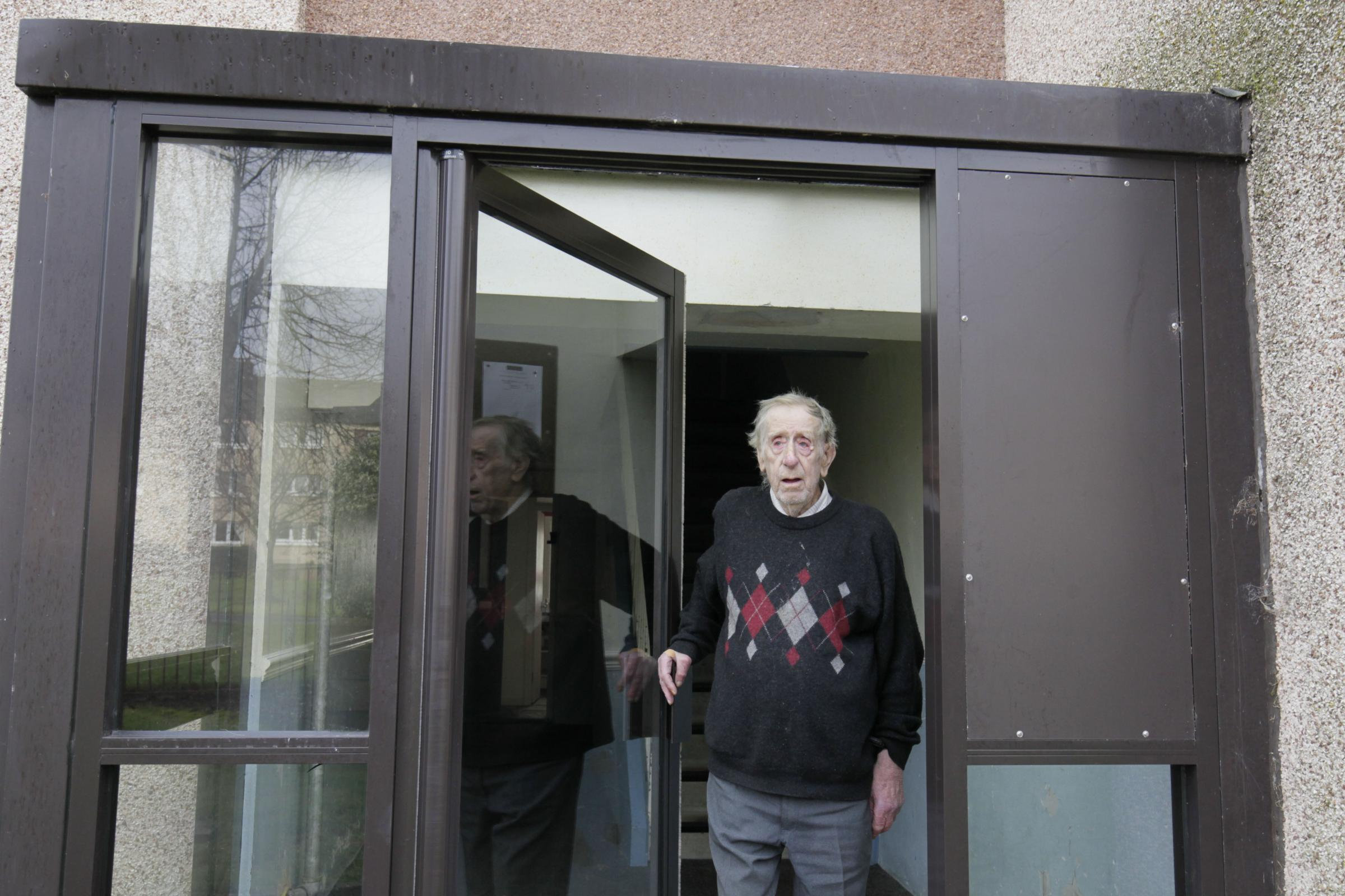 George Collins outside his Woodstock Avenue home last year.