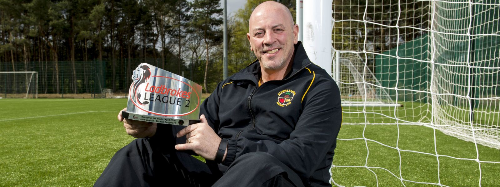 John Coughlin with one of the many manager of the month awards he won at Berwick Rangers