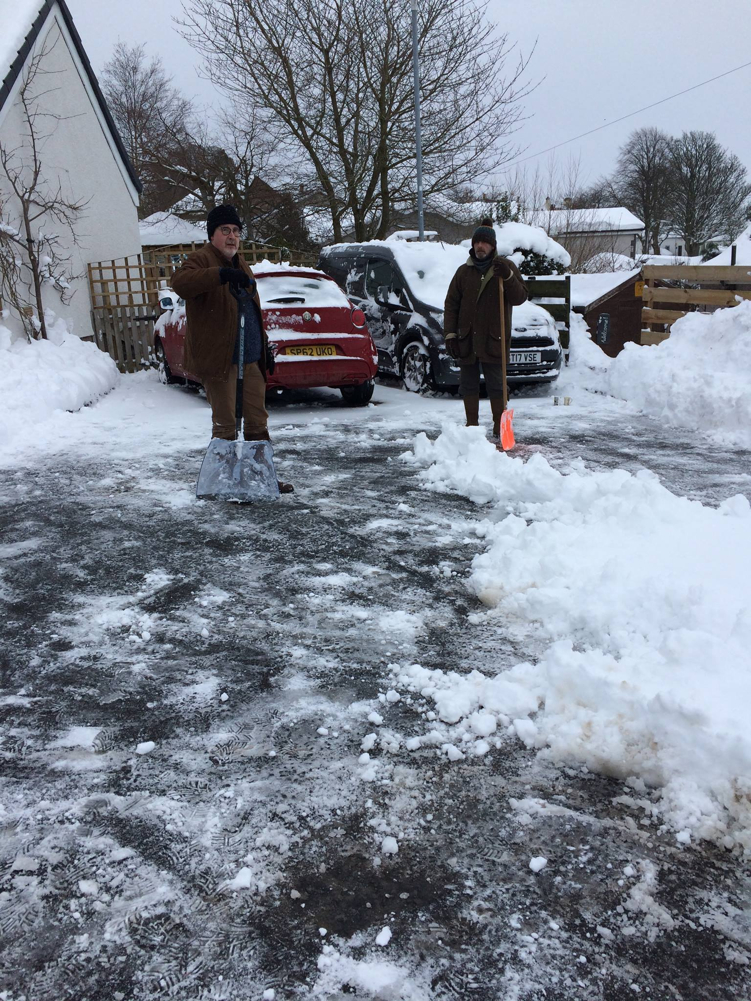Residents in Bowden out clearing snow from paths and car parks. Photo: Andrea Beavon