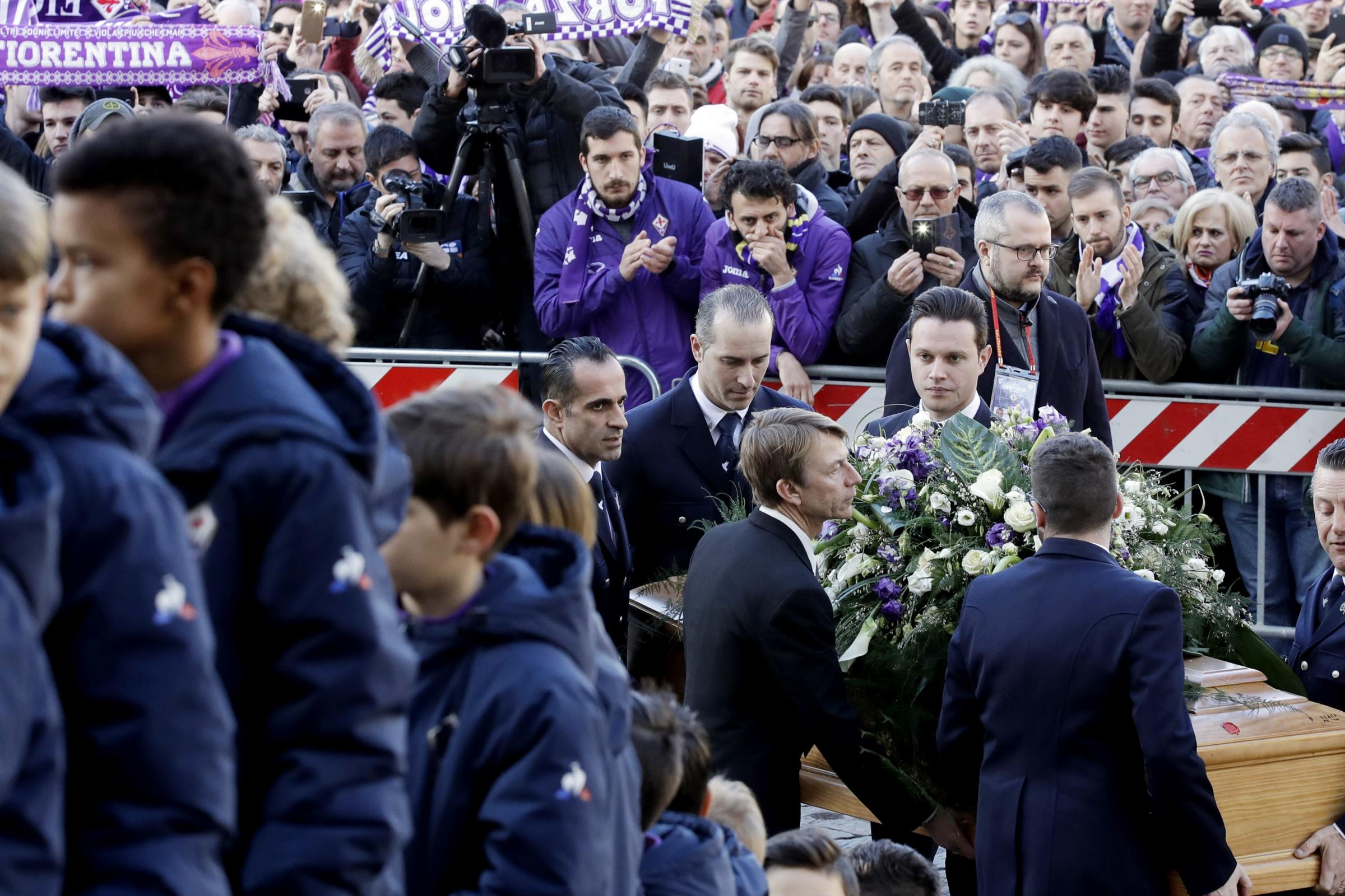 Thousands of mourners gathered for the funeral of Davide Astori (Alessandra Tarantino/AP)