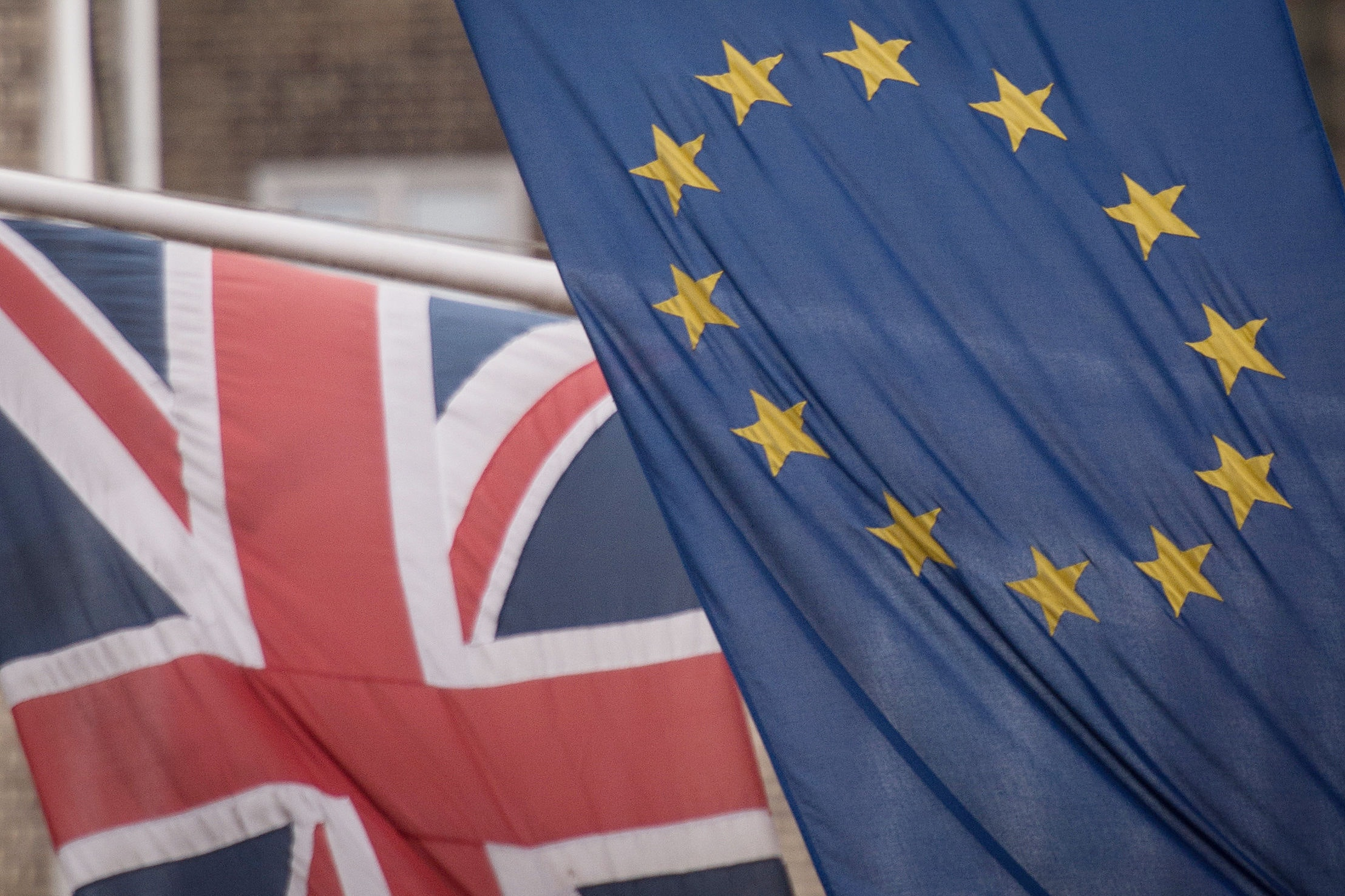 "File photo dated 17/2/2016 of the EU and Union flags. An influential MPs' committee has voiced ""grave concerns"" over the complacency of the Government's Department for Business in preparing for Brexit."