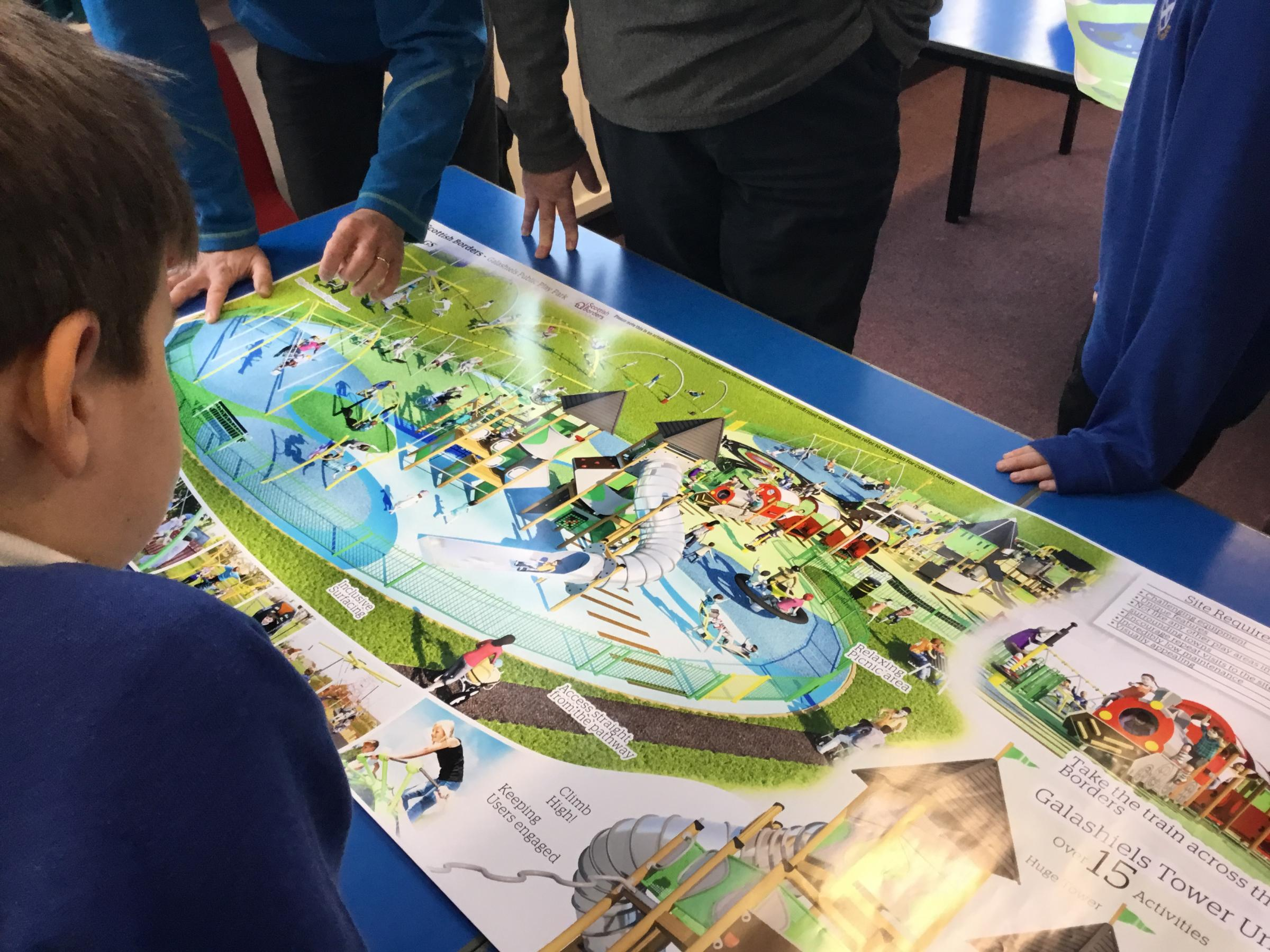 St Peter's Primary pupils look over the plans. Photo: SBC