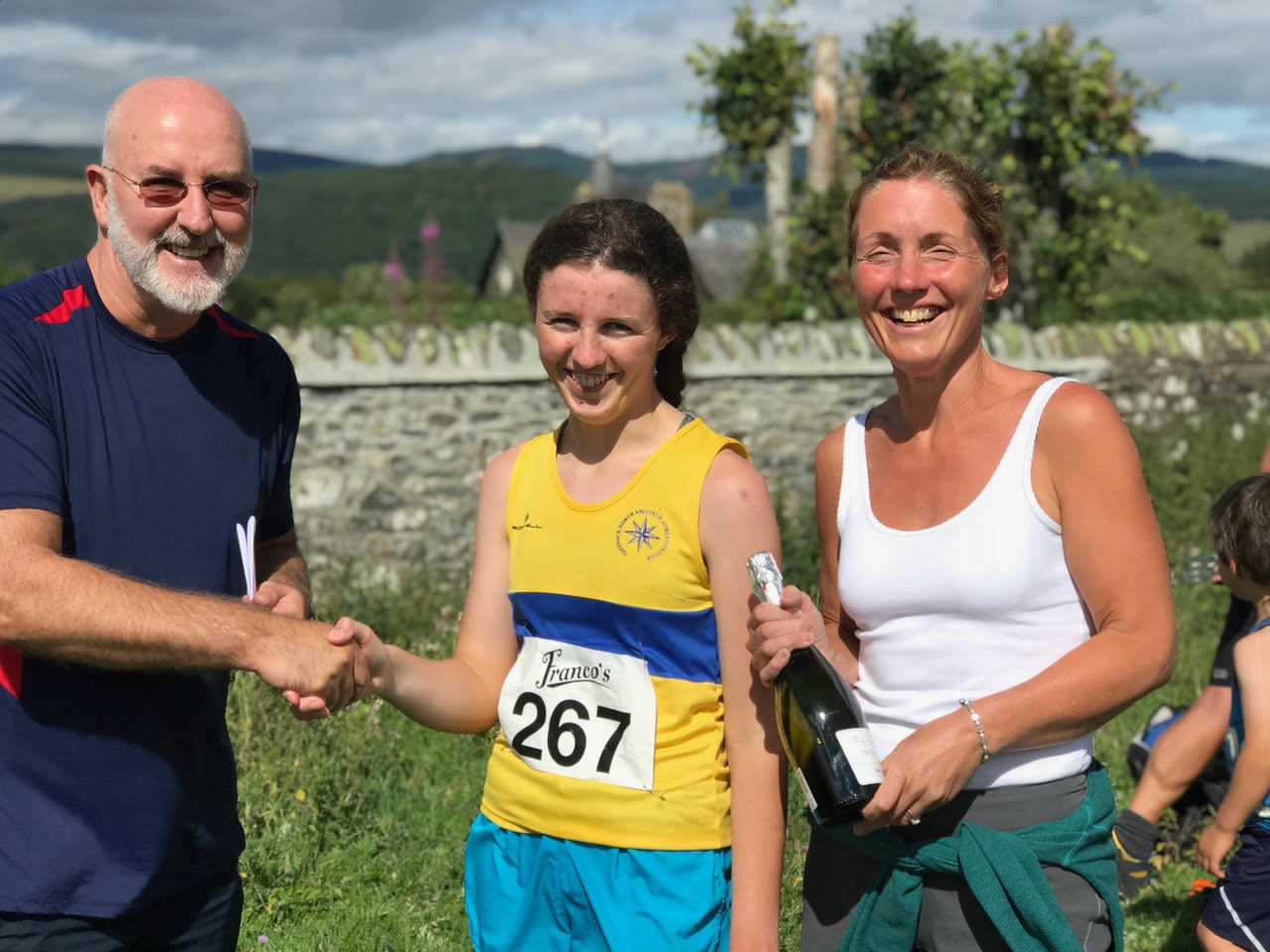 Rhona Mowat and her mum collect the prize from race organiser Gregor Nicholson