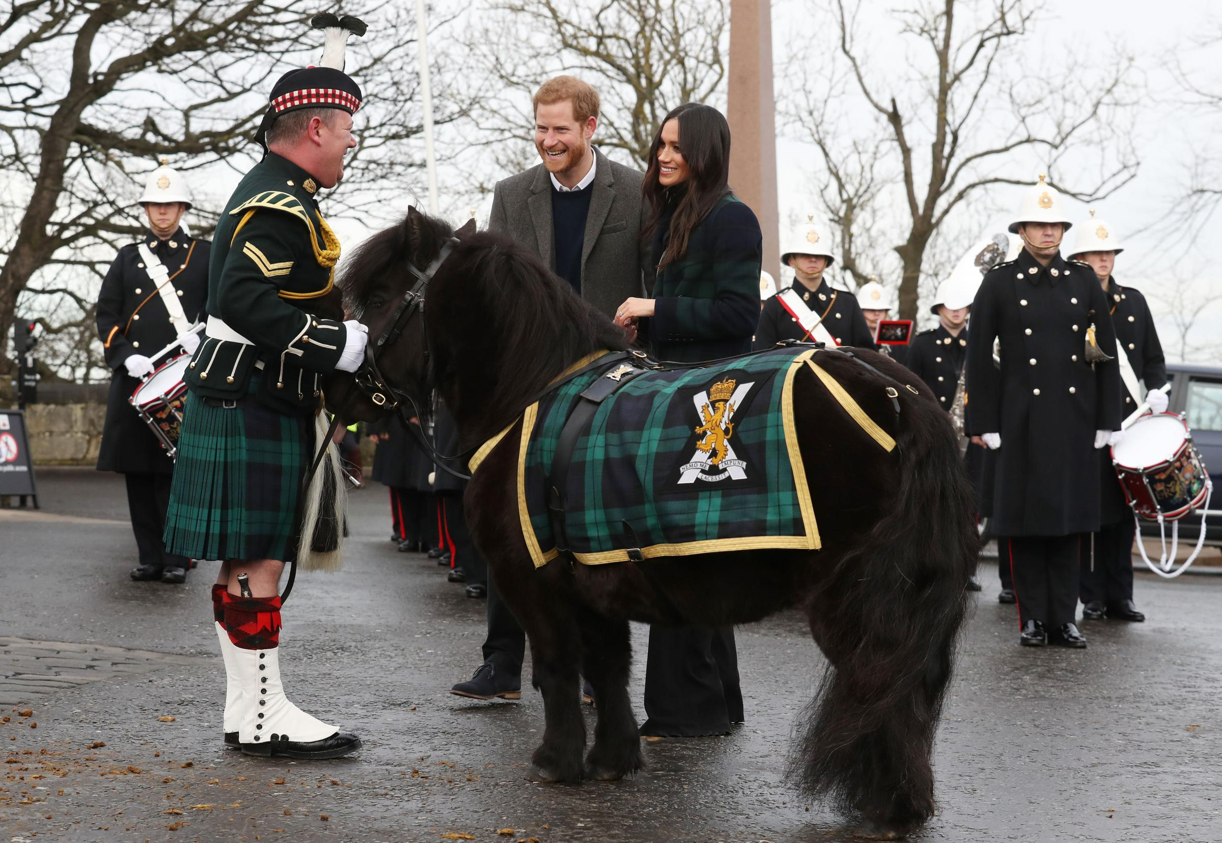 Prince Harry and Meghan Markle meet Pony Major Mark Wilkinson and regimental mascot Cruachan IV during a walkabout on the esplanade at Edinburgh Castle, during their visit to Scotland. PRESS ASSOCIATION Photo. Picture date: Tuesday Februar