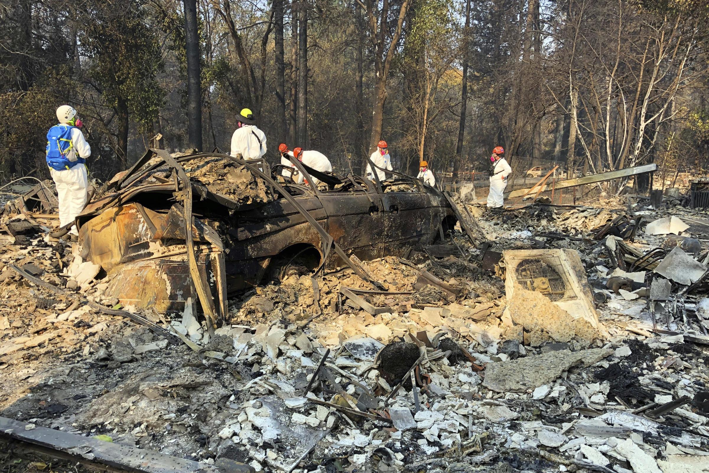 Hundreds searching rubble in California for wildfire bodies as rain looms