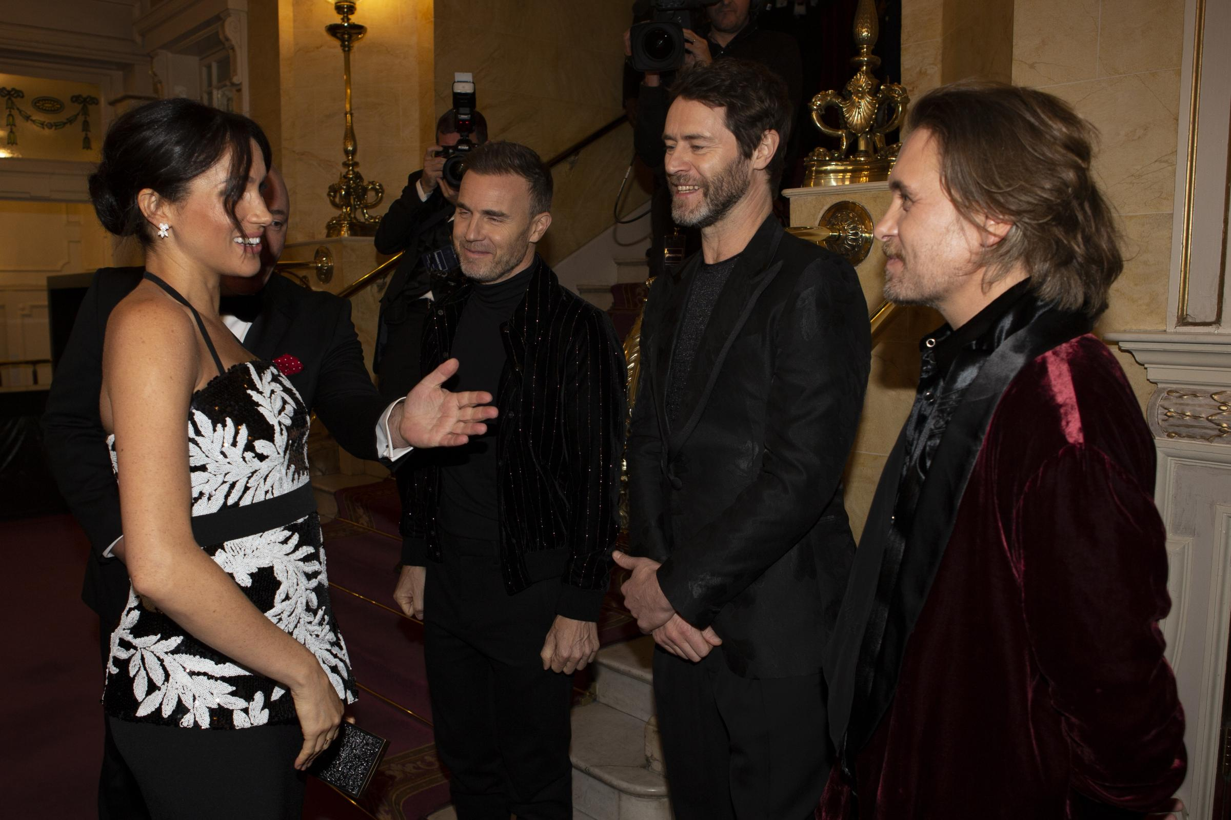 Meghan welcomed by Take That as she makes Royal Variety debut