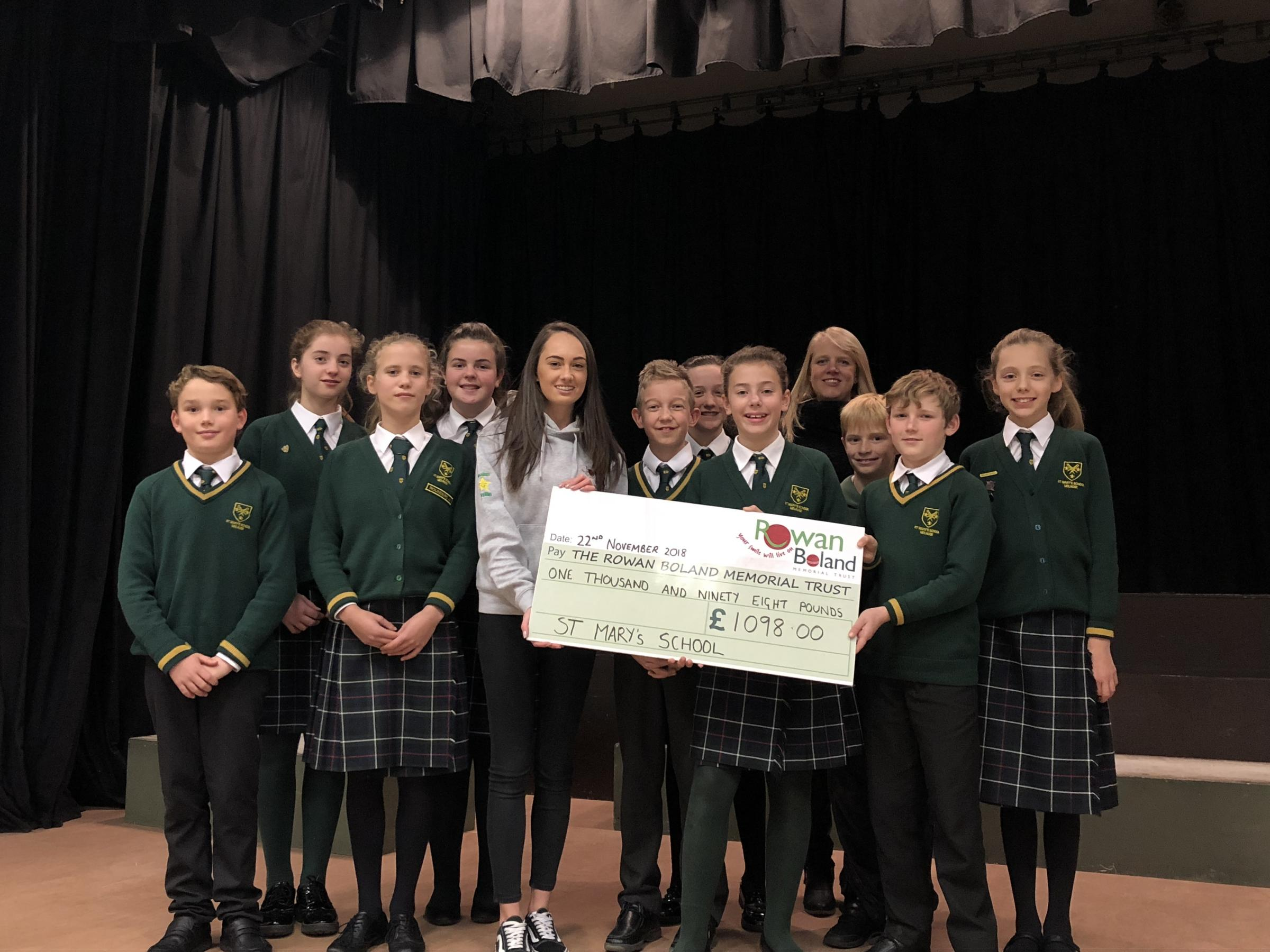 Kirstin Boland collects the cheque