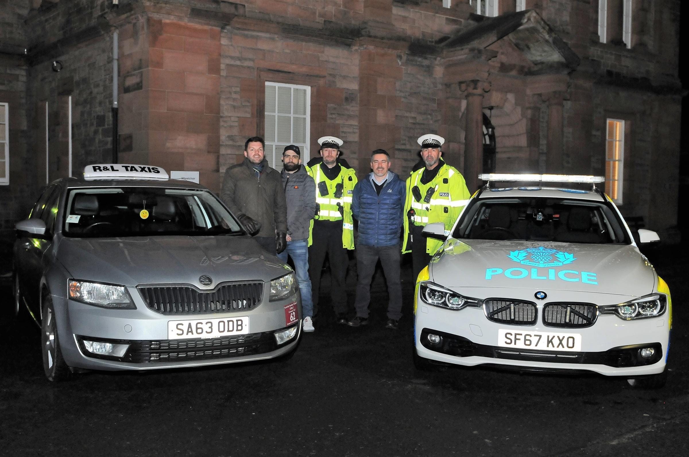 Bruce Mercer, Bryan Hoggan and PC Conal McEwan are joined by traffic officers. Photo: Grant Kinghorn
