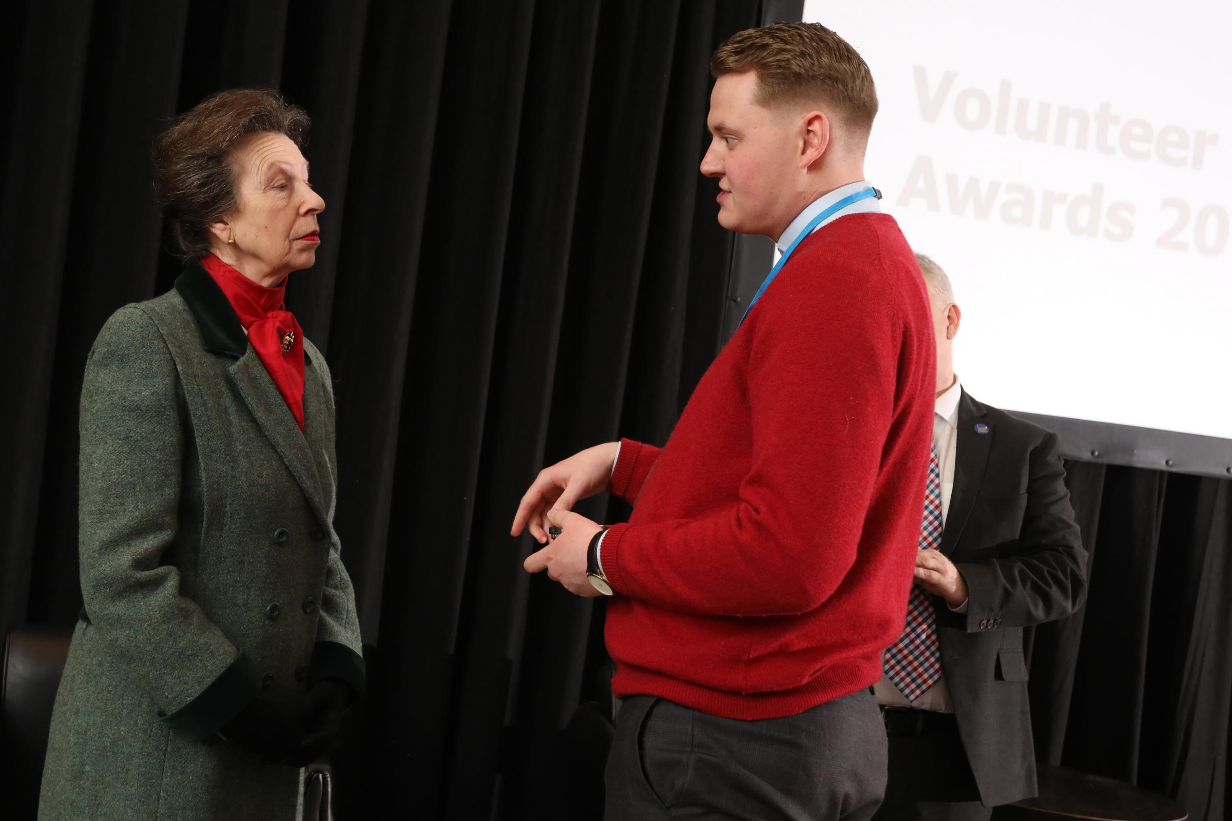 Ewan Imray receiving the award from Princess Anne.
