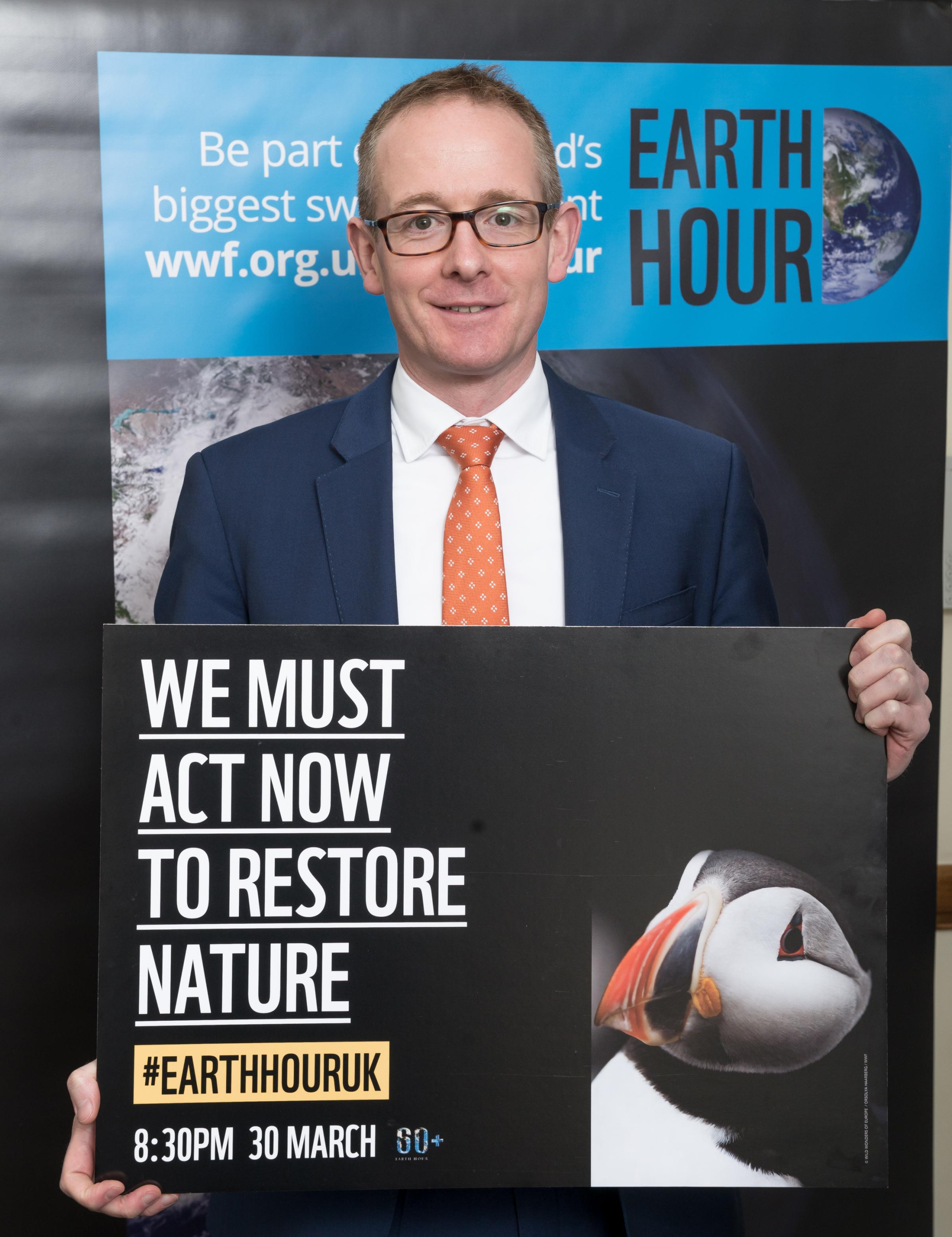 MP showing support for WWF UK Earth Hour, Westminster Palace, London19th March.2019.