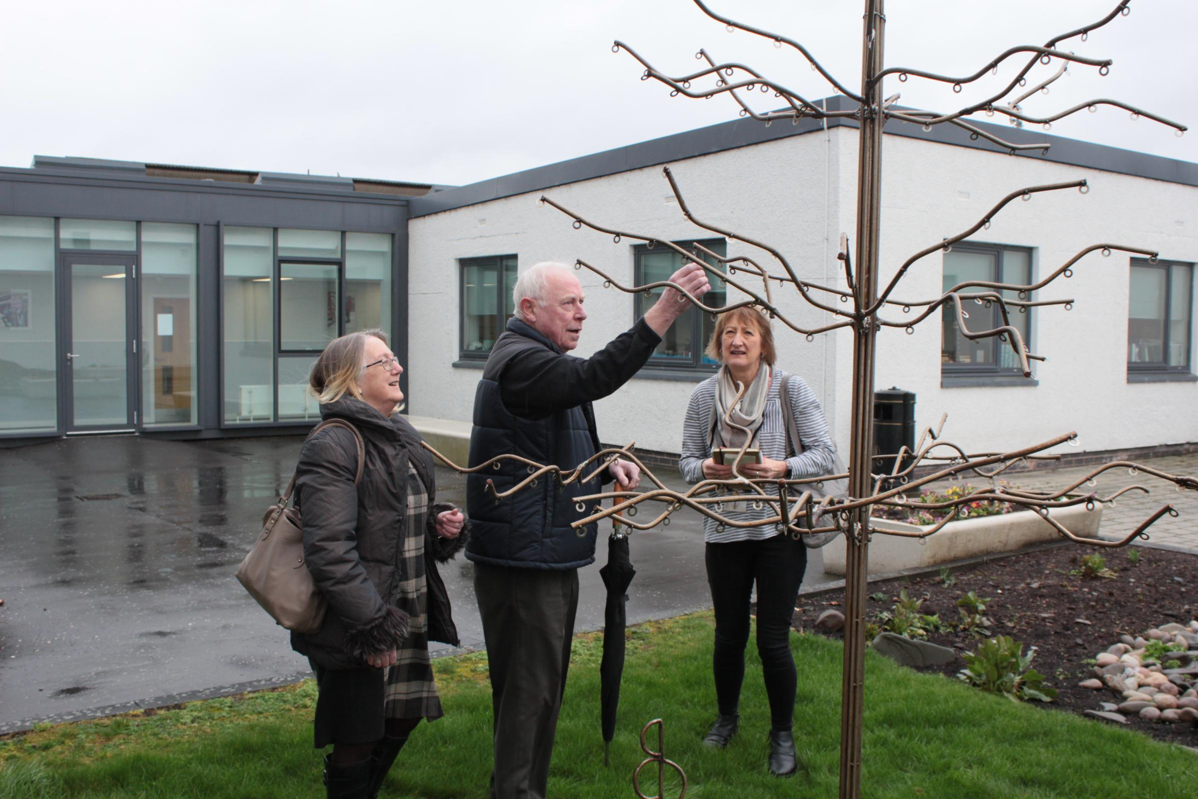 Stuart's parents, Sheila and Ian, were invited to give the tree its first leaf.